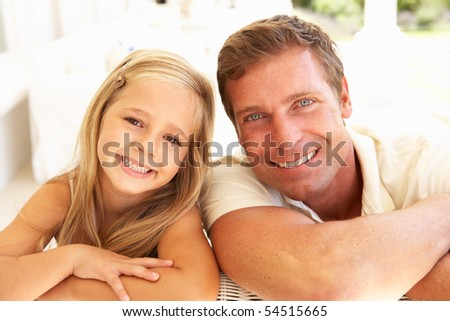 Portrait Of Mother And Daughter Relaxing Together On Sofa