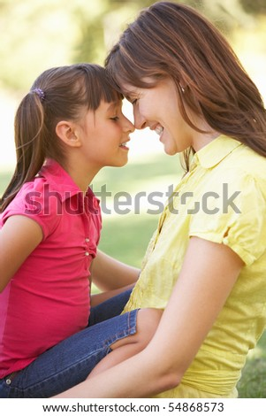 Portrait Of Mother And Daughter Together In Park