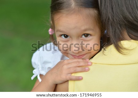 Portrait of mother and her daughter in late spring outside - stock photo