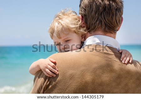 Portrait of mother and her little son on a beach - stock photo