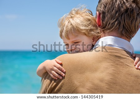 Portrait of mother and her little son on a beach