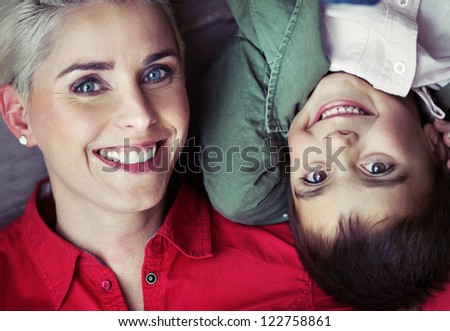 Portrait of mother and her son - stock photo