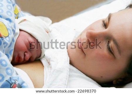 portrait of mother and just born baby - stock photo