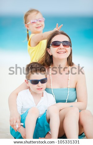 Portrait of mother and kids at beach having fun
