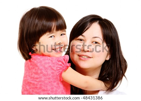 Portrait of mother and small daughter looking at camera - stock photo