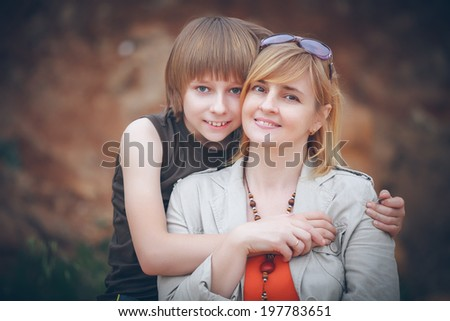 portrait of mother and son - stock photo