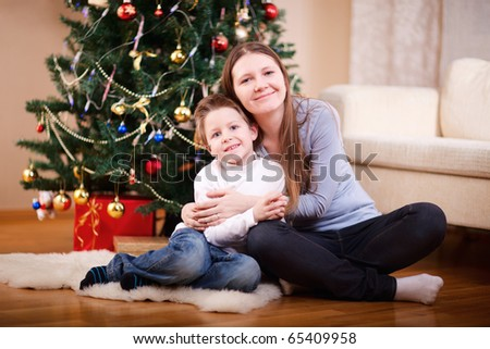 Portrait of mother and son at home on Christmas time - stock photo