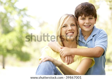 Portrait Of Mother And Son In Park - stock photo