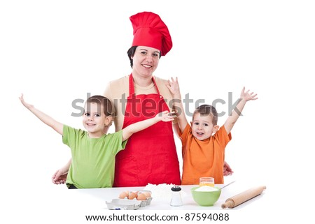 Portrait of mother and sons together in the kitchen - stock photo