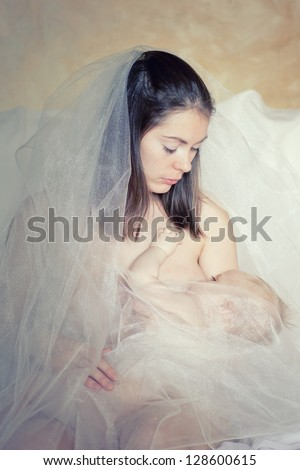 portrait of mother breast-feeds the baby - stock photo