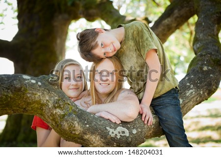 Portrait of mother, daughter and son in nature. Shallow DOF, focus on boy's face. - stock photo