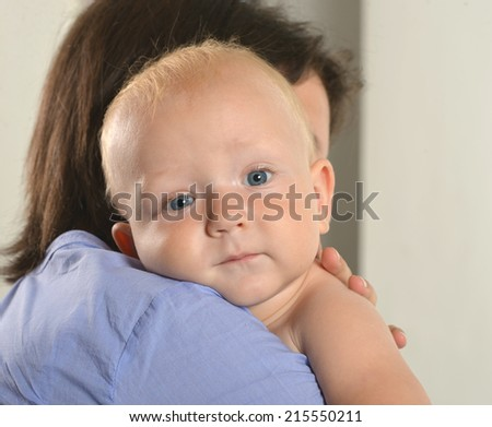 Portrait of mother holding baby boy  closeup