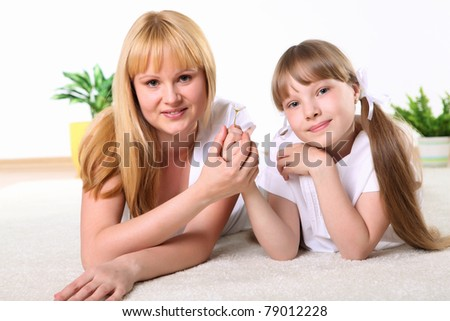 portrait of mother together with daughter in studio