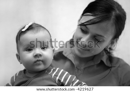 portrait of mother with baby, black and white - stock photo