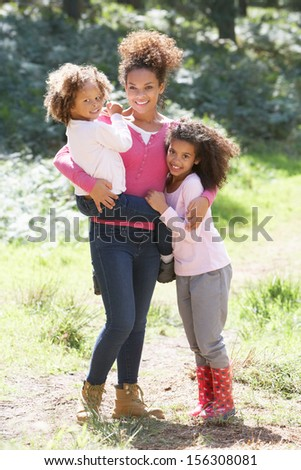 Portrait Of Mother With Daughters In Countryside - stock photo