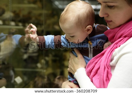 Portrait of mother with her baby in the museum - stock photo