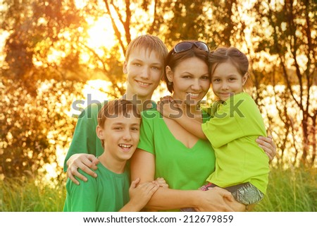 Portrait of  mother with her children outdoors