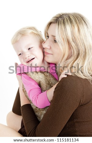 portrait of mother with her crying little daughter