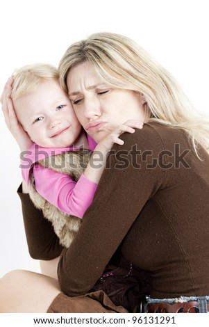 portrait of mother with her crying little daughter - stock photo