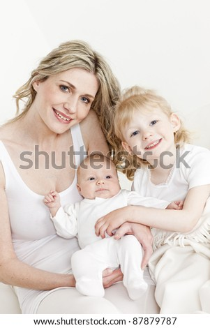 portrait of mother with her daughters