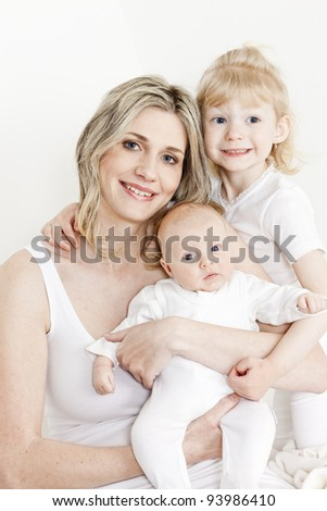 portrait of mother with her daughters - stock photo