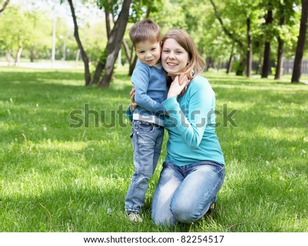 Portrait of mother with her little son in the park