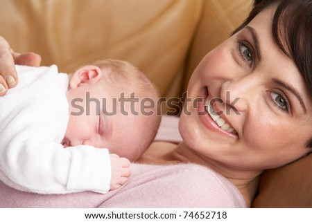 Portrait Of Mother With Newborn Baby At Home - stock photo