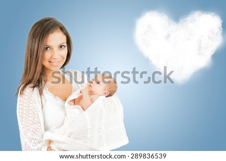 Portrait of  mother with newborn baby  with heart shaped cloud background  - stock photo