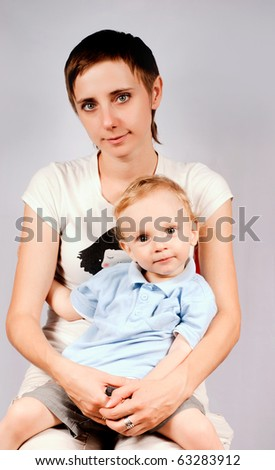 Portrait of mother with toddler look at �amera