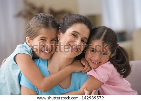 Portrait of mother with two daughters