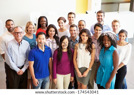 Portrait Of Multi-Cultural Office Staff Standing In Lobby - stock photo