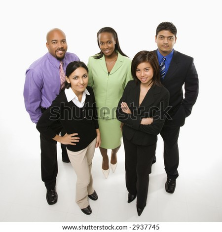 Portrait of multi-ethnic business group standing looking at viewer. - stock photo