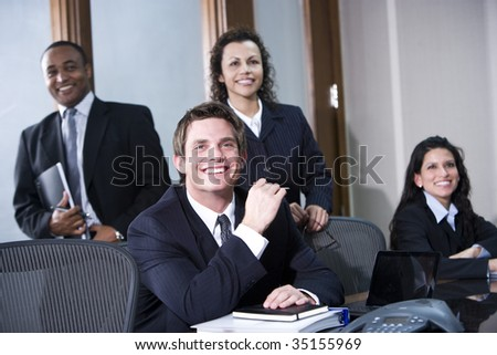 Portrait of multi-ethnic office co-workers - stock photo