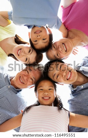 Portrait Of Multi-Generation Chinese Family Looking Down Into Camera - stock photo