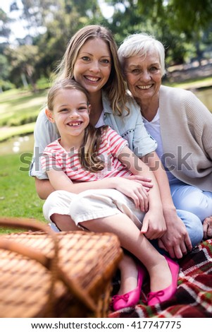Portrait of multi-generation family having a picnic in the park - stock photo