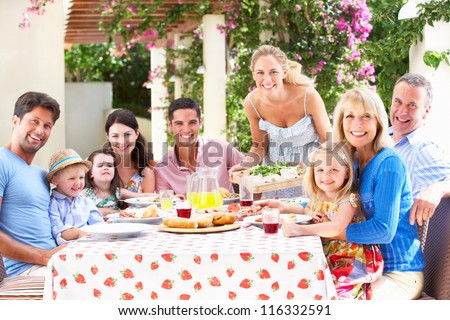 Portrait Of Multi Generation Family Meal - stock photo