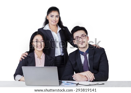 Portrait of multi racial business team with three members looking and smiling on the camera, isolated on white - stock photo