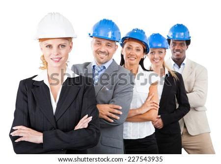 Portrait of multiethnic architects wearing hardhats while standing arms crossed against white background - stock photo