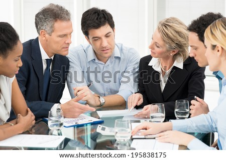 Portrait Of Multiracial Businesspeople Brainstorming In Meeting - stock photo