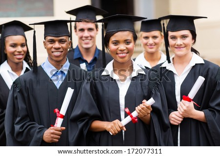 portrait of multiracial graduates holding diploma - stock photo