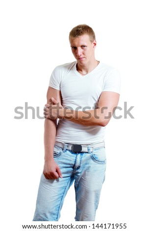 Portrait of muscle athletic man posing in studio