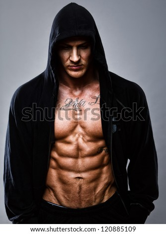 Portrait of muscle man posing in studio - stock photo