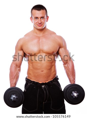 Portrait of muscle man posing in studio with dumbbells on white background - stock photo