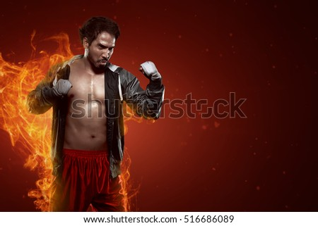 Portrait of muscular asian male boxer in dramatic light