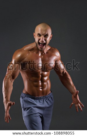 Portrait of muscular screaming men. Studio shoot - stock photo