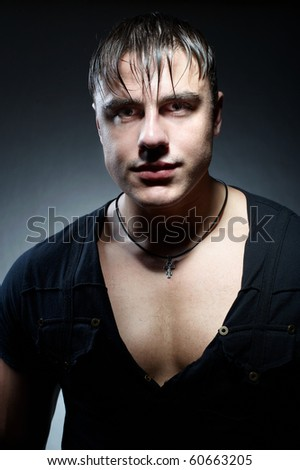 Portrait of muscular young handsome man - stock photo