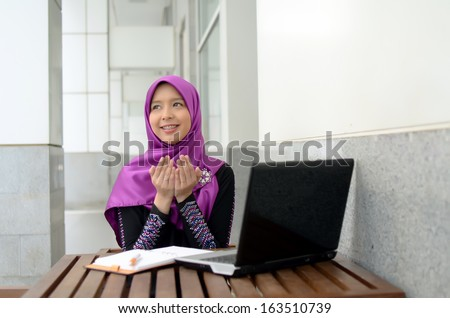 Portrait of muslim girl pray and smile - stock photo