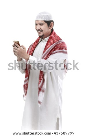 Portrait of muslim man using cellphone isolated over white background