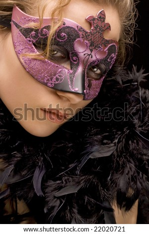 portrait of mysterious blond woman wearing purple stylish carnival mask and black feathers, role play - stock photo