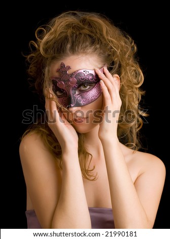 portrait of mysterious blond woman wearing purple stylish carnival mask; role play - stock photo